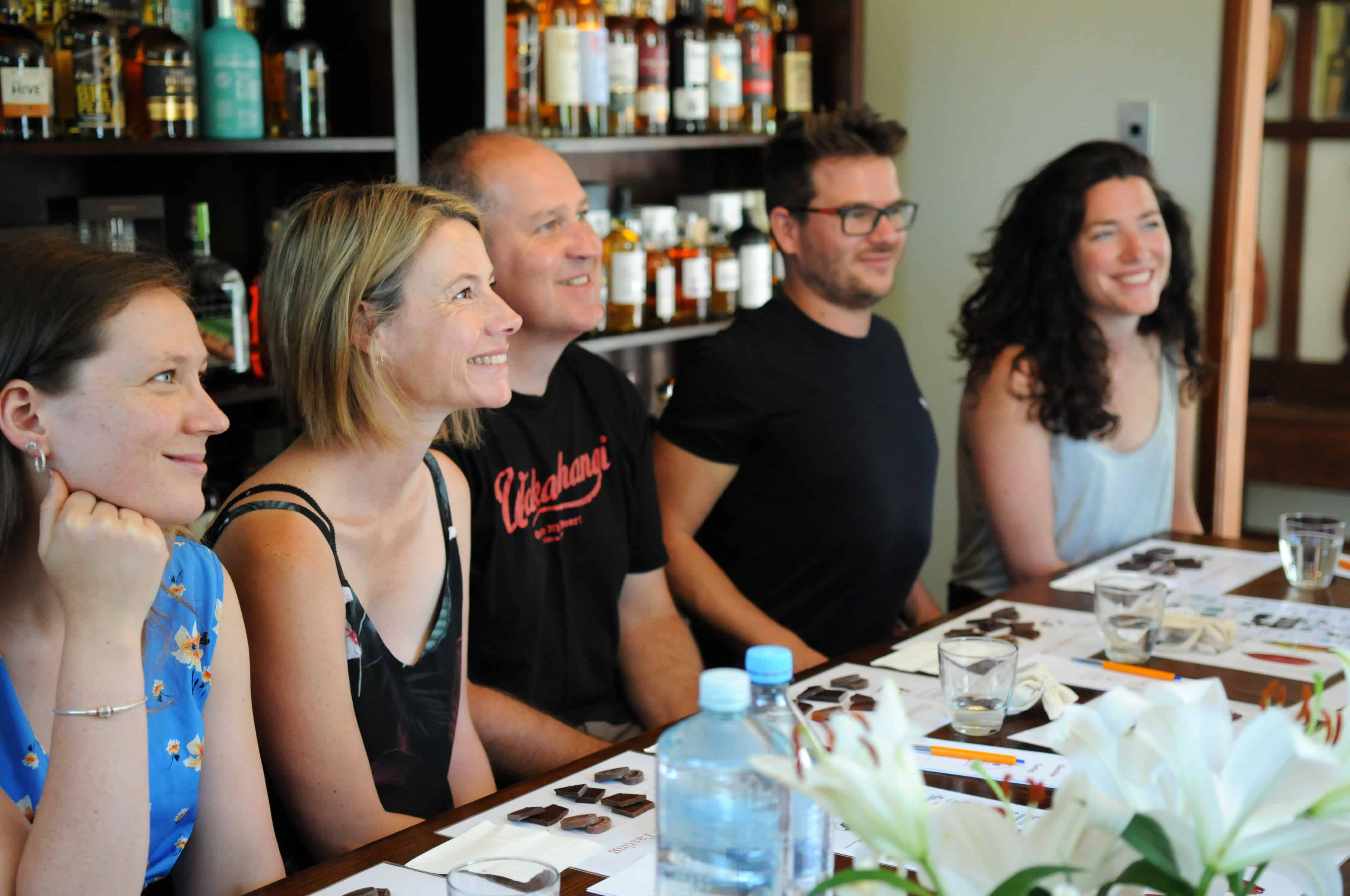Happy people at a chocolate tasting workshop {Events New Zealand}